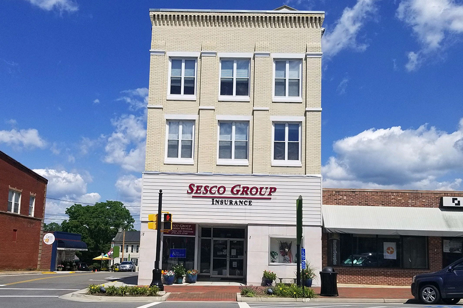 Wytheville, VA - Street View of Tall Sesco Group Insurance Office Building Located at a Corner Intersection in Wytheville, Virginia on a Sunny Day
